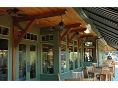 Wood timber brackets paired with this awning make a great outdoor space for eating or socializing.