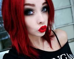 smoky eyes, bright red hair & lips. and pale skin <3 love.