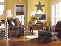I have similar yellow walls with white paneling and will tone them down by using dark leather furniture and mixing in more colors as shown. I even have two rustic stars :D