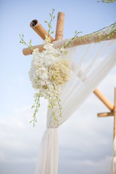 Beach wedding arch idea - has flowers at the top-middle, too. wedding-ideas