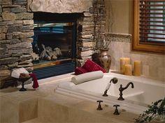 Fireplace next to bathtub!