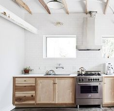 white kitchen with birch or poplar beams and cabinetry...Fuzzzzzco kitchen in Charleston