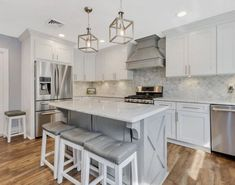 """Modern Farmhouse Kitchen in White and Gray. Shaker style #cabinetry with the classic """"X"""" design at the #KitchenIsland. . Featuring: Ice White Shaker and Lait Grey Shaker kitchen . . #TesiDesignInc -- Interiors & Cabinetry is a proud dealer of @ForeverMarkCabinetry. #ModernFarmhouseKitchen #ModernFarmhouse #KitchenDesign #Whiteandgreykitchen #shaker #shakercabinets #shakerstyle #modernfarmhousestyle Grey Kitchens, Modern Farmhouse Kitchens, Modern Farmhouse Style, Grey Shaker Kitchen, Gray And White Kitchen, Bathroom Cabinetry, Colonial Style Homes, Shaker Cabinets, Eat In Kitchen"""