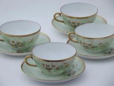 vintage Bavaria porcelain cups and saucers w/ field of hand-painted daisies