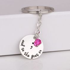 """""""and so she goes on"""" semicolon keychain"""