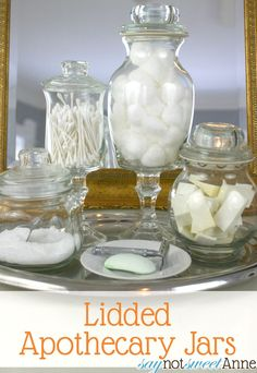 DIY Upscale Apothecary Jars - There are knobs that can be used for this that come in an assorted set in scrape booking isles.