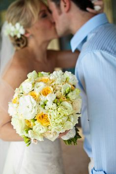 Very light yellow and white flowers with blue ribbon on the stems, could be a pretty idea!