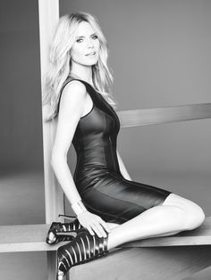 The German model rocks a  little black leather dress. HEIDI KLUM SHOWS WHAT'S TRENDING IN MACY'S INC CAMPAIGN
