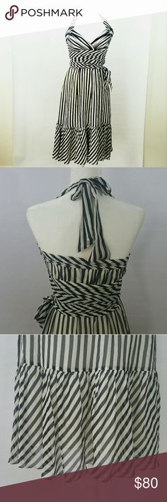 BCBG MAXAZRIA BACKLESS DRESS WHITE BLACK STRIPE Gorgeous light weight BCBG DRESS with ruched waist to esentuate curves. Dress can tie around the waist 3 different ways - side front and back. Ruching detail on bust *Has one snag under waist but can not be seen when belt is tied* BCBGMaxAzria Dresses Midi