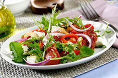 Impress your guests with a fabulous mixed green salad made with sun dried tomatoes, roasted red peppers and crumbled tangy feta cheese.