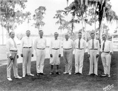 """Title-Managers of the Haven Villa Corporation pose outdoors - Winter Haven, Florida 1924 or 1925 1. W.C. Amos, Assistant Director of Sale. 2. Mayor H.G. McCutcheon, 1st Vice President. 3. John A. Snively, Senior President. 4. A.M. Tilden, Secretary-Treasurer. 5. R.A. Henry. 6. G. Duncan Bruce. 7. Chandler Dean, Florida Sales Director. 8. George L. Dick, General Director """"The golden-tongued orator.""""  Photographer/Personal Author Dahlgren, Robert E."""