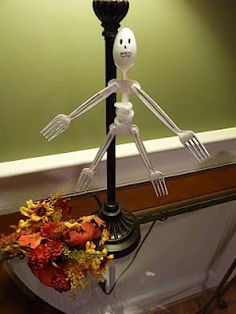 Skeleton using plastic spoons and forks.
