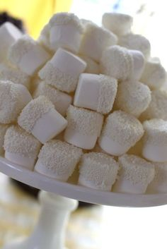 White chocolate covered marshmallows? Dipped in white sprinkles or coconut.