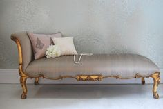 JOHN DICKINSON (1920-1982) Pair of benches wrapped in ivory raw silk fabric with loose suede seat cushion. American, c. 1968 £1,019.00 This chaise oozes pure elegance, with delicate hand carvings, finished in a slightly distressed gold gilt paint and upholstered in a sumptuous raw silk fabric. Unique in that it has no back/side and therefore looks fabulous with the arm rest either to the left or the right. This pi