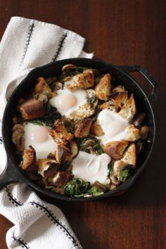 Baked Eggs with Mushrooms, Spinach & Bread http://marenellingboe.com/2014/01/20/baked-eggs-with-mushrooms-spinach-bread/