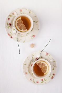 Lemon slices artfully arranged in teacups... { #lemontea }