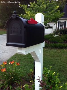 Spruce up old mailbox by cleaning post with OxiClean and then paint with a semigloss latex exterior paint, add a new mailbox (and house numbers.