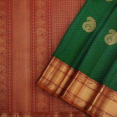 This elegant kanjivaram sari woven in dark green with self jacquard pattern has paisley motifs in gold zari dotted across the body. Kanjivaram Sarees Silk, Indian Silk Sarees, Kanchipuram Saree, Pure Silk Sarees, Cotton Saree, Fancy Blouse Designs, Sari Blouse Designs, Bridal Silk Saree, Saree Wedding