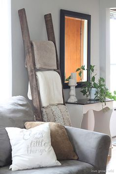 Propped up against a wall in the living room, this repurposed ladder holds a few neatly folded blankets out of the way.