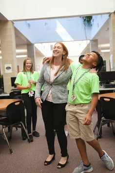 District SEL coordinator Erin Dawson laughs with an eighth grade member of Cold Springs' Student Leadership Team.