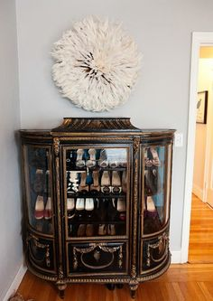 Omg that curio is gorgeous. Would match my buffet perfectly. The shoes are cute too