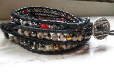 bracciale con hematite silver, hematite gold, quarzo dalmata e corallo