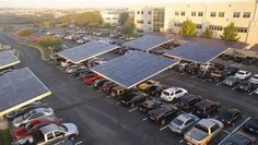 """What a perfect marriage: electric car recharging and solar power. Envision Solar's """"groves"""" shade parking lot vehicles while also capturing power from the sun. Solar Car, Solar Roof, Diy Solar, Pv Panels, Solar Panels, Renewable Energy, Solar Energy, Tree Structure, Solar Power System"""
