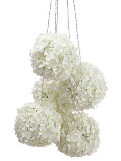 Looking for artificial hanging flowers for your DIY wedding? Check out this hanging decoration that has faux silk hydrangea pomander flower balls with LED lights. Hanging hydrangea kissing balls on this LED light string create an elegant centerpiece for any event or reception! #fauxflowers