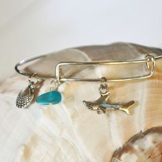Expandable Alex and Ani type bracelet with Shark, Sea Glass and a Shell by SeaglassI on Etsy https://www.etsy.com/listing/195261569/expandable-alex-and-ani-type-bracelet