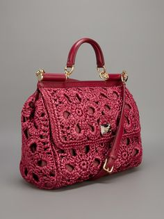 Who says crochet is no longer cool?  Look at this display of Dolce e Gabbana handbags!