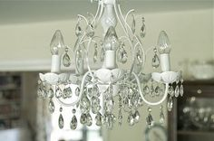 1950s Chic Chandelier...Simple with a Can of White High Gloss Spray Paint...Tutorial from Aimee @ itsoverflowing.blogspot.com