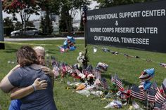 Sophia Ensley, right, and Barbie Branum hug in front of an Amnicola Highway memorial for victims of the July, 16 shootings on Saturday, July 18, 2015, in Chattanooga, Tenn. U.S. Navy Petty Officer Randall Smith died Saturday from wounds sustained when gunman Mohammad Youssef Abdulazeez shot and killed four U.S. Marines and wounded two others and a Chattanooga police officer.  Photo by Doug Strickland /Times Free Press