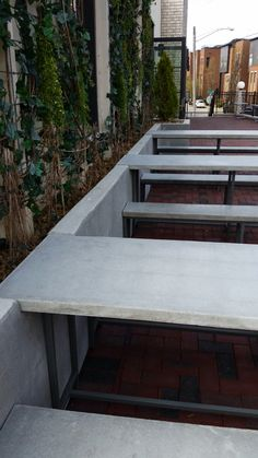 Concrete patio tables and benches built by Metal Fred Designs for Butchertown Hall in Nashville TN Industrial Furniture, Outdoor Furniture, Outdoor Decor, Concrete Patio, Cement, Restaurant Patio, Patio Wall, Delicious Restaurant, Built In Bench