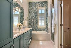 beach house bathroom with blue tile + vanity