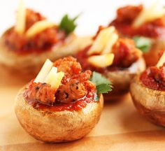 Spicy Sausage Stuffed Pizza Mushrooms...Picture how fabulous these skinny snacks would be served at your ladies only Super Bowl cocktail party, as a way to sneak some healthy goodies into the buffet at your husband's Super Bowl gathering, or even as a fabulous spread at your next Fantasy Football draft.