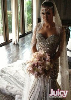 Amber Ridinger J'aton Couture; beautiful dress...the rest I could do without