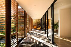 Florida-based studio Brillhart Architecture has completed a home fronted by slatted wooden shutters in a lush Miami forest