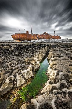 This 1940s-era steam trawler was carrying whiskey, yarn and stained glass when the strength of two consecutive storms pulled it atop the rocky coast of Inisheer (Inis Oírr) in the Aran Islands. Thankfully, the entire ship crew was saved, but the ship remains stuck along the shore.