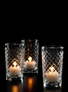 Cut clear glass squares votive tealight holder bud vase wedding reception bar lounge restaurant lights interior decorating party event table crystal - interspersed with regular votive holders among fir branches either on mantle, console, or table