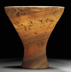 A LARGE MESOPOTAMIAN ALABASTER CHALICE Circa 2500 B.C. With a pedestal base, slender waist and wide conical body, the exterior of the rim offset by an encircling shallow groove, the vessel sculpted so as to exploit the natural bands of the stone 10 7/8 in. (27.6 cm) high