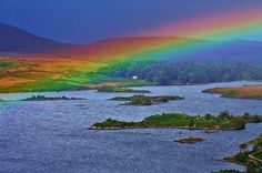 Rainbow Blessing by liamfm. Glenveigh, Co. Donegal, Ireland.  Rainbow fact: There are really no specific bands of color in a rainbow, just a continuous spectrum of colors. It is only because of the photopigments in our human eyes and the photoreceptor outputs in our brains that make us think we're seeing color bands. Not only that, but the colors we see may vary from person to person. Wow! Who knew?