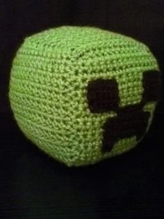 Minecraft Creeper VG-CUBE. This 6 1/2 inch VG-CUBE is made of 100% acrylic yarn, stuffed with Polyester Fiber Fill, and is a take on the Creeper from Minecraft. $15.00 #creeper #minecraft #knitted #plushie