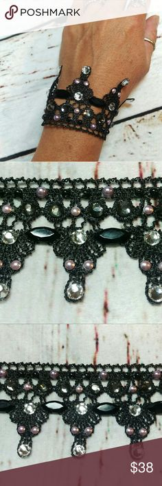 """Black lace cuff bracelet Very elegant black lace and rhinestone cuff bracelet. Perfect for any occasion, this bracelet is made with black Venice lace embellished with black and clear rhinestones and light lavender pearls. It measures approximately 5.5"""" by 1.5"""" and has a chain and lobster clasp Jewelry Bracelets"""
