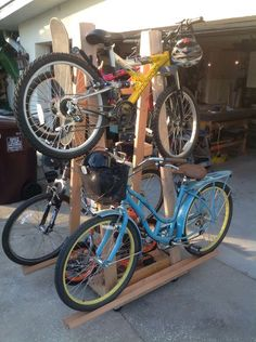 Rolling Bike Rack: How to get five bicycles, two scooters and one skateboard to occupy the same space in your garage at once. You can move all 8 at once in one step. Rack Velo, Bicycle Rack, Bicycle Shop, Bicycle Stand, Bike Storage Rack, Diy Garage Storage, Garage Organization, Storage Ideas, Tool Storage