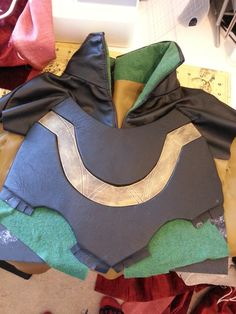http://khaoskostumes.com/2013/06/28/how-to-make-a-loki-costume-part-7-chest-and-wrist-armour/