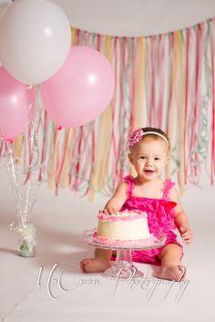 Cake smash. love the ribbon background.