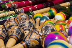 Stock Photo titled: Display Of Colorful Mexican Musical Instruments For Sale Including Maracas And Wood Flutes., unlicensed use prohibited