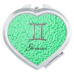 A stylish little compact mirror with Gemini birth sign in a silver color on a lovely emerald green mottle design. A great little gift idea for someone born under the Zodiac sign of Gemini. #birth-signs #zodiac #birthstone-colors #horoscope-signs #birth-symbol #symbols #gemini #emerald #green #emerald-green #silver #zodiac-symbols #zodiac-gift-ideas #birth-stone-colors #gemini-birth-signs #gemini-symbols #gemini-gifts