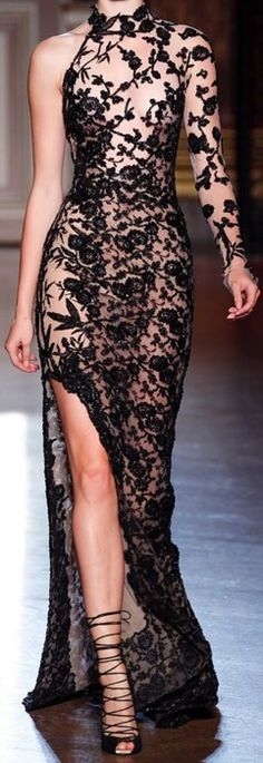 Nude, black & lace one sleeve gown with split!  Über sexy