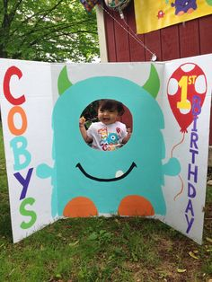 1st birthday face in hole photo booth opportunity for baby and guests